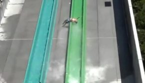 Young Boy Flies Off Of A Three-story Waterslide