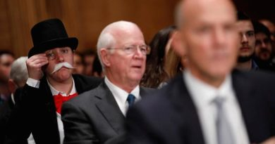 Someone Dressed as The Monopoly Guy Photo Bombs Equifax Hearing